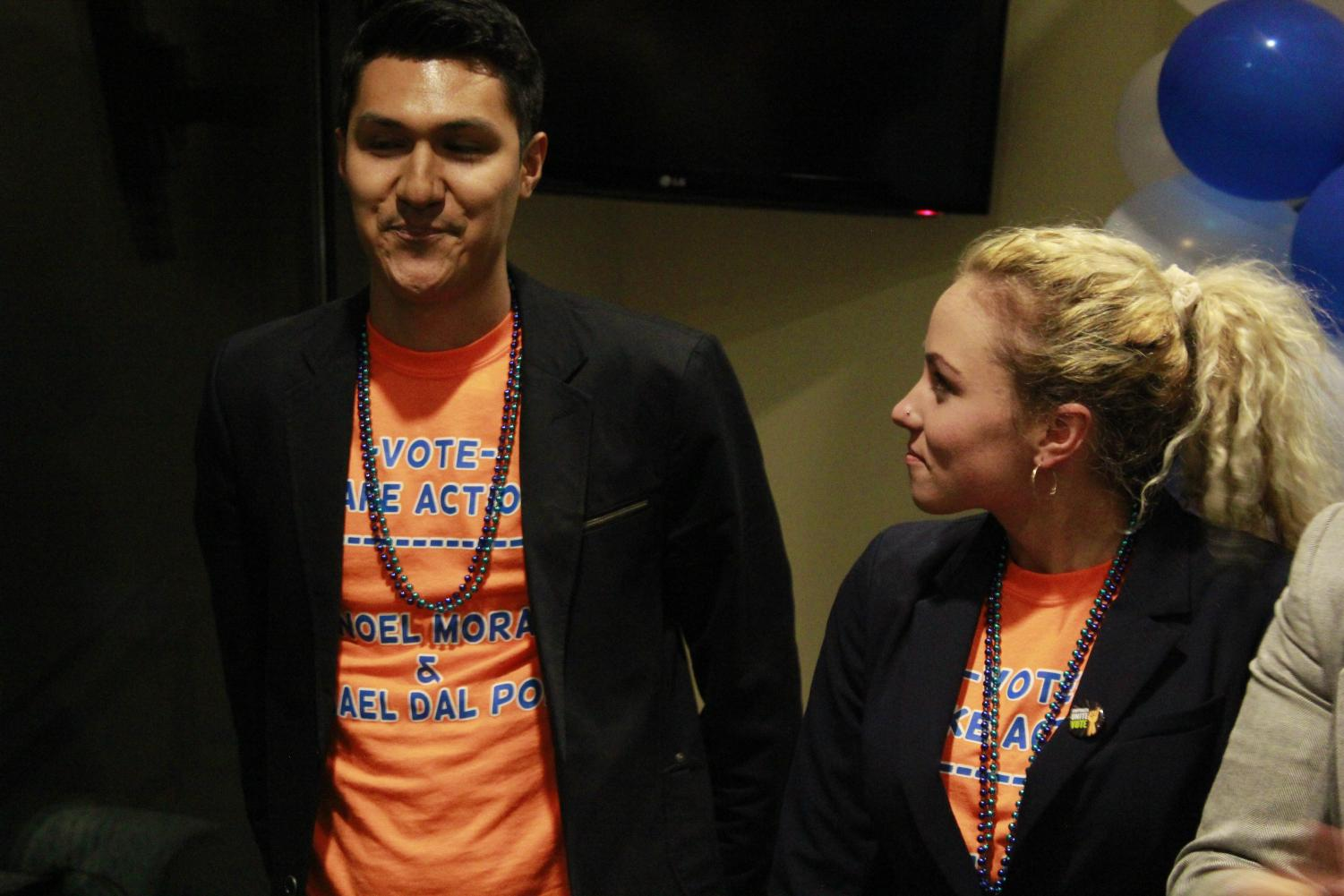 Noel Mora and Rachael Dal Porto as they hear the results of the ASI elections on April 11, 2018, at the elections party. The president's ticket, consisting of the two candidates, ran unopposed for the president and executive vice-president positions.