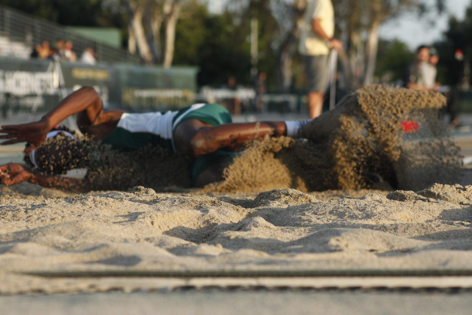 Sacramento State sophomore Jah Strange lands in the triple jump pit before finishing in second place in the Causeway Classic Duel against UC Davis at Hornet Stadium on Friday, April 28, 2018. Strange also earned a personal best of 24-11.75 for first place in the long jump.