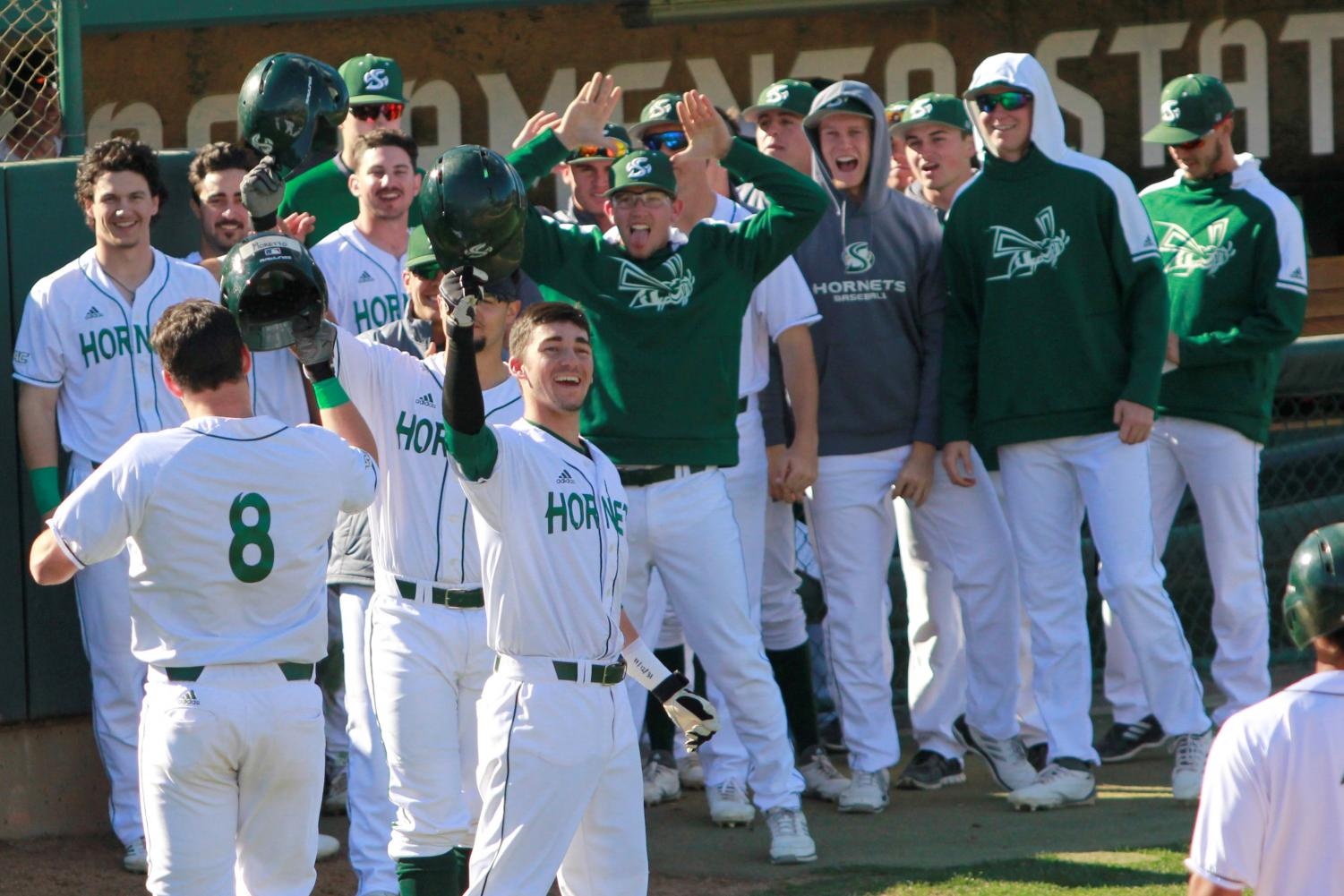 Sacramento State freshman infielder Steven Moretto, far left, celebrates with his teammates following his first home run of his career against the University of Washington at John Smith Field on Sunday, Feb. 18, 2018. The Hornets defeated the Huskies 6-0.