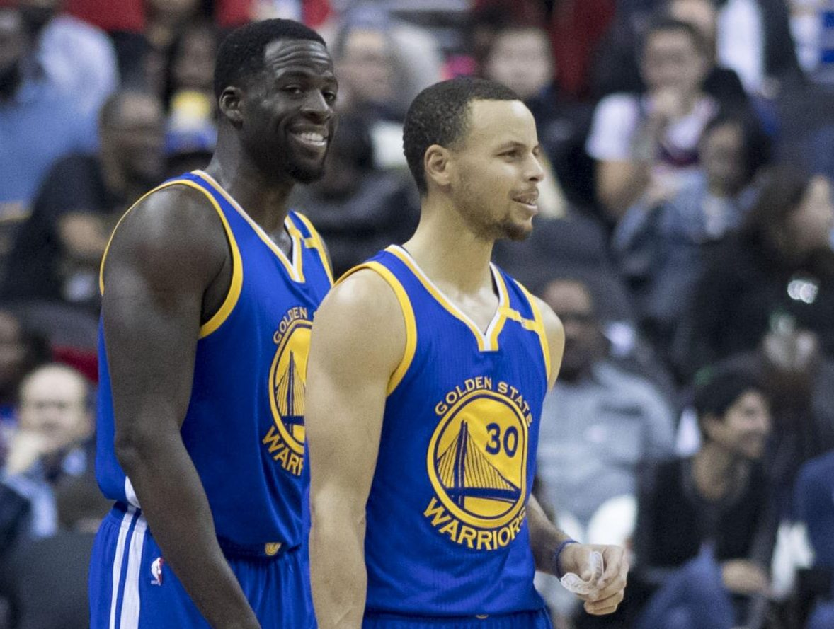 Steph Curry and Draymond Green of the Golden State Warriors come onto the floor of Capital One Arena in Washington, D.C. on Feb. 28, 2017. Curry, Green, and the rest of the Warriors have built up a substantial bandwagon fan base with their success.