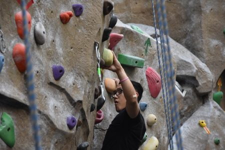 Ethan Veslenio, who joined the rock climbing club this semester, scales a rock wall in the WELL on Thursday, May 3. Sac State's rock climbing club was voted in as the best sports/recreation club on campus for the Best of Sac State.