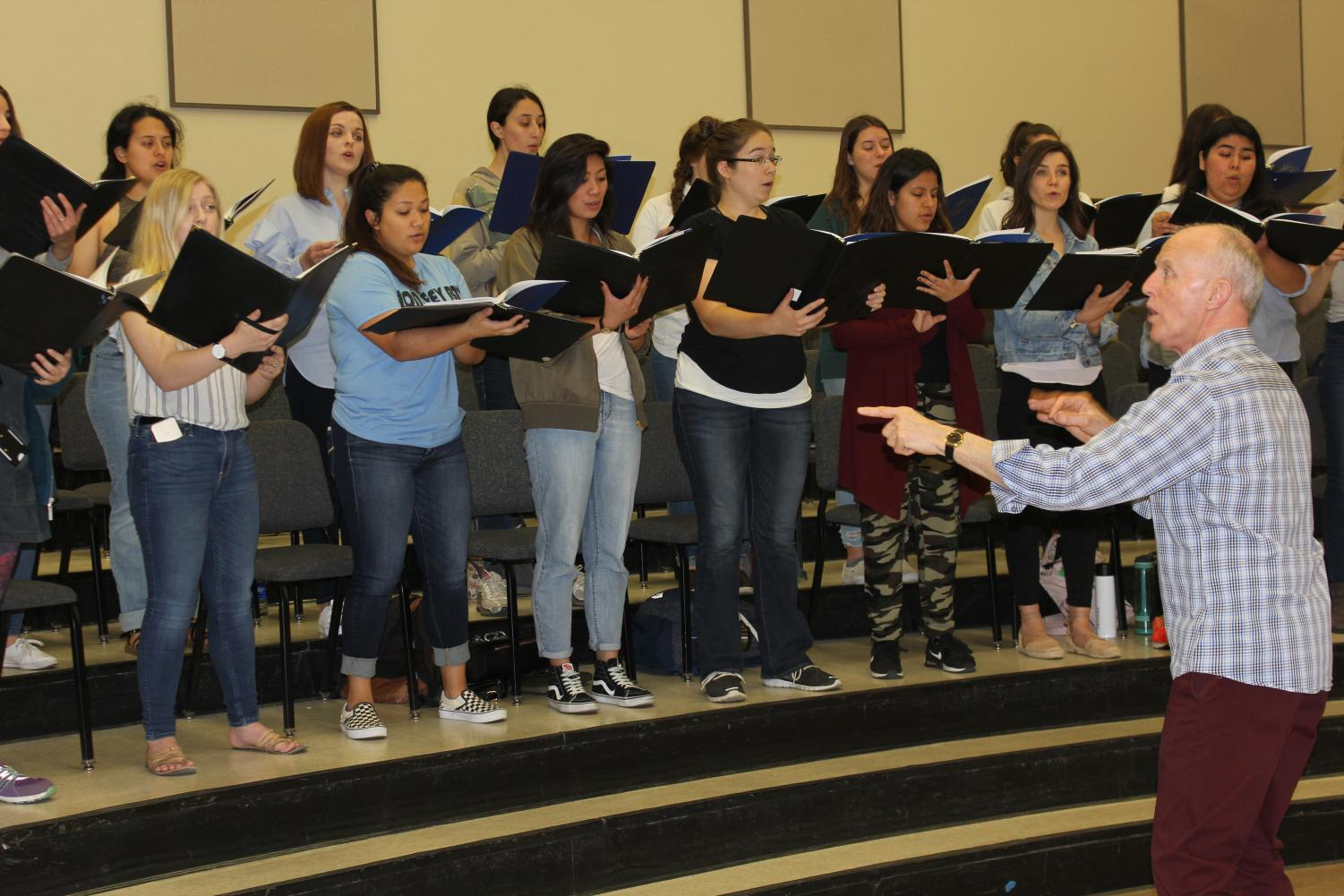 Choir director Donald Kendrick and the Sacramento State women's chorus rehearse