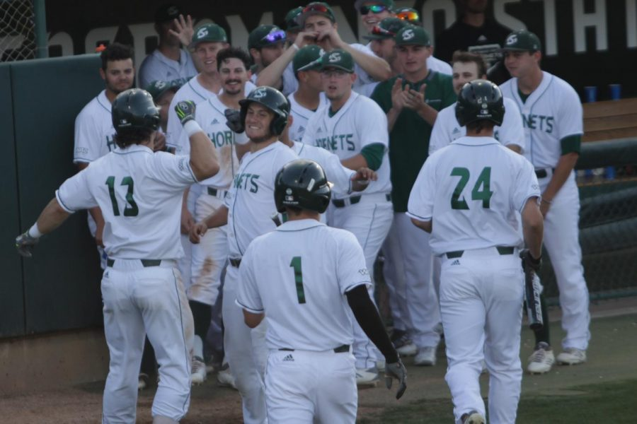 The Sacramento State baseball team celebrates after junior outfielder James Outman, far left, hits a home run against Seattle University at John Smith Field on Friday, May 4, 2018. The Hornets defeated the Redhawks 5-1.