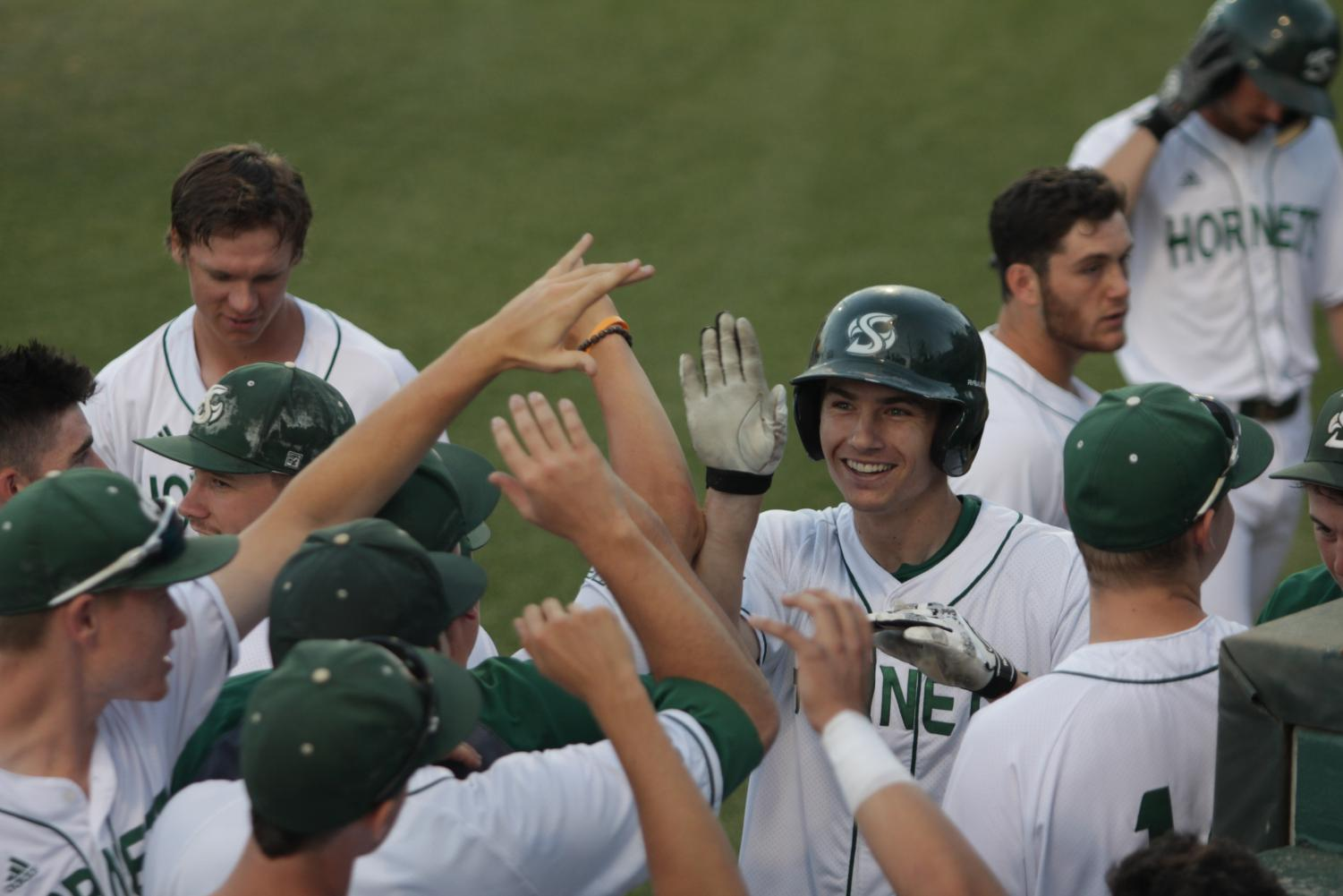 The Sacramento State baseball team celebrates after senior outfielder Andrew McWilliam, center, hit a home run against UC Davis at John Smith Field on Tuesday, May 8, 2018. The Hornets defeated the Aggies 5-2.