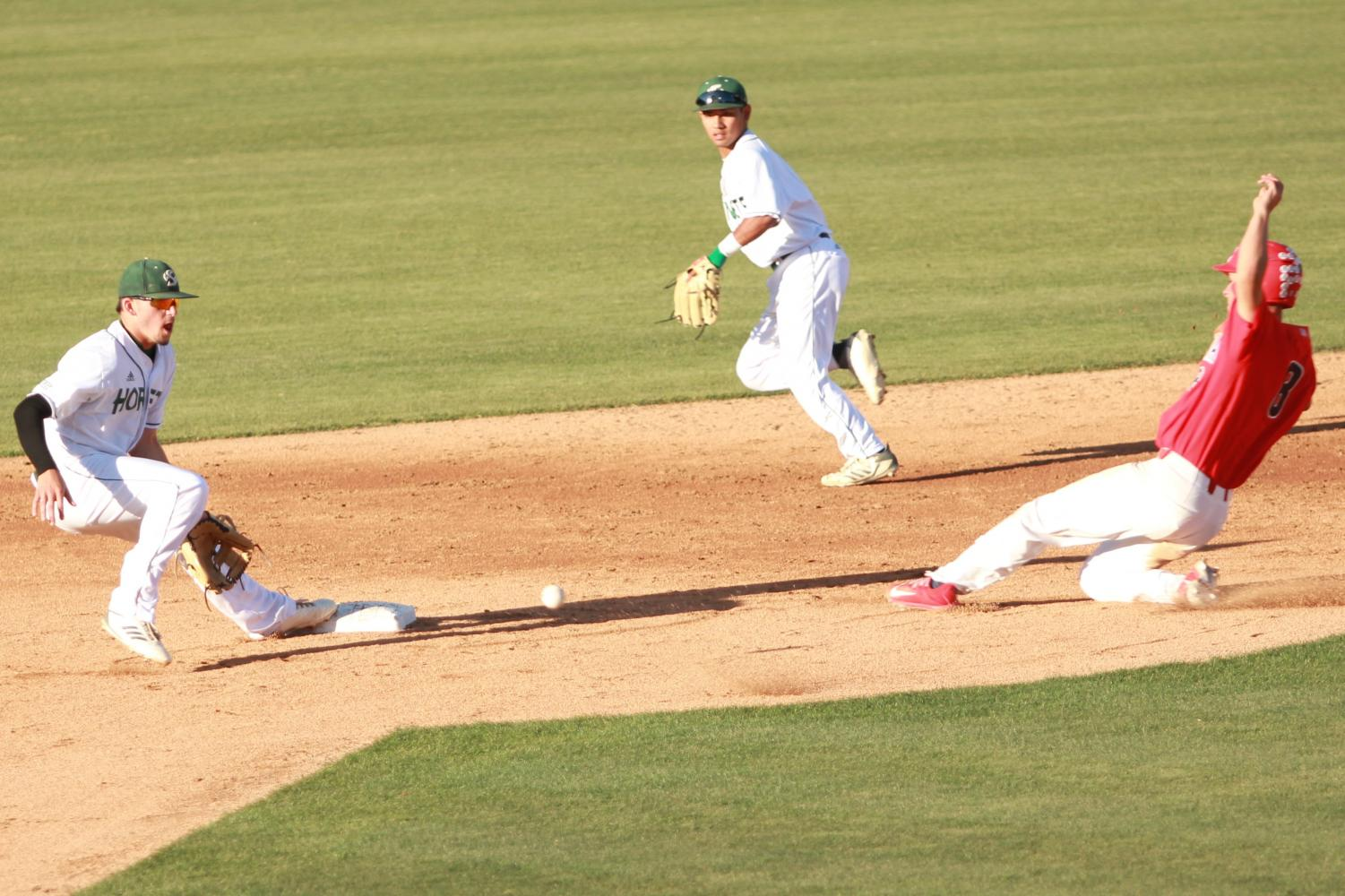 Sacramento State sophomore infielder Josh Urps, left, prepares to catch the ball as Hornets freshman infielder Keith Torres, back, backs up the throw to second as University of Arizona freshman outfielder Donta Williams, right, slides in safely on Monday, May 14, 2018 at John Smith Field. The Hornets lost to the Wildcats 5-2.