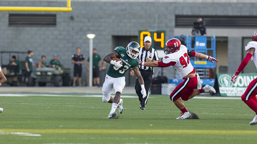 Sacramento State freshman running back and kick returner Elijah Dotson attempts to avoid a defender during Sep.9 game against Incarnate Word at Hornet Stdium. The kick return is one of the most exciting plays in football, but might go extinct due to concerns for player safety.