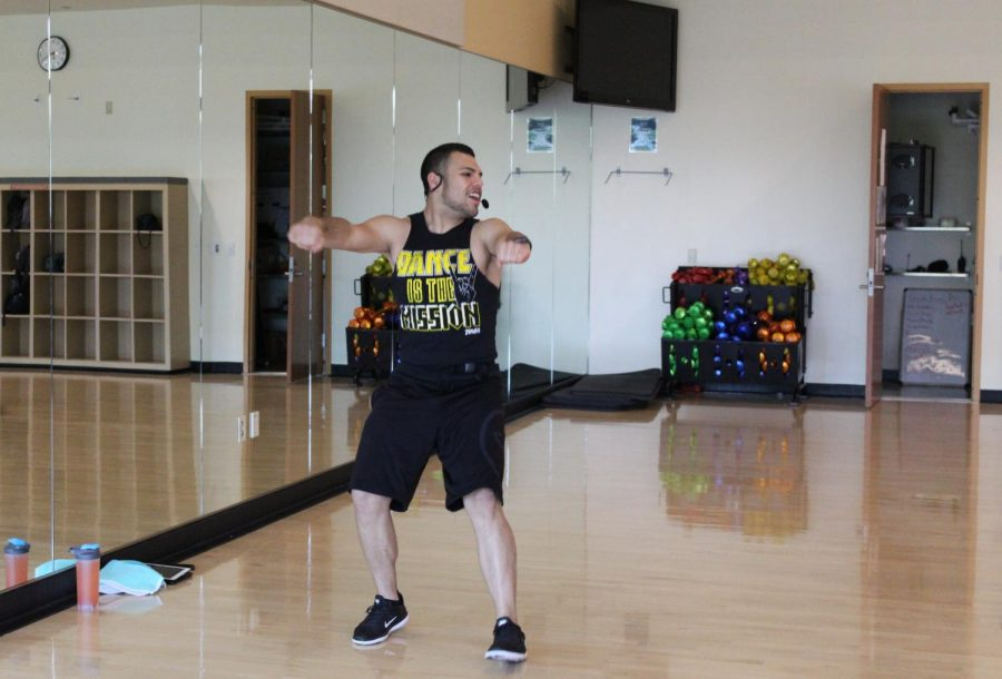 Alex+Zamora+instructs+his+Zumba+class+on+the+second+floor+of+The+WELL+on+May+1%2C+2018.+Zumba+was+chosen+by+students+as+the+best+fitness+class+taught+at+The+WELL+in+The+State+Hornet%E2%80%99s+Best+of+Sac+State+2018+survey.