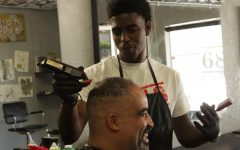 Alumnus cuts hair for Sac State athletes
