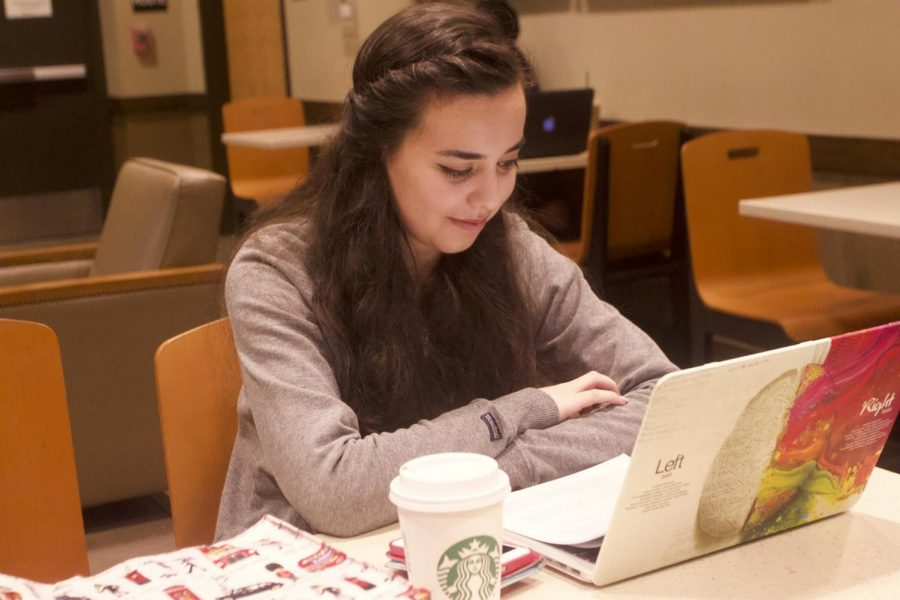 Sacramento State student Ashley Thomas works on her homework at the Starbucks on Sac State's campus, Thursday, May 3, 2018. A simple cup of coffee is a low calorie choice effective in keeping your body awake when your mind might not always be.