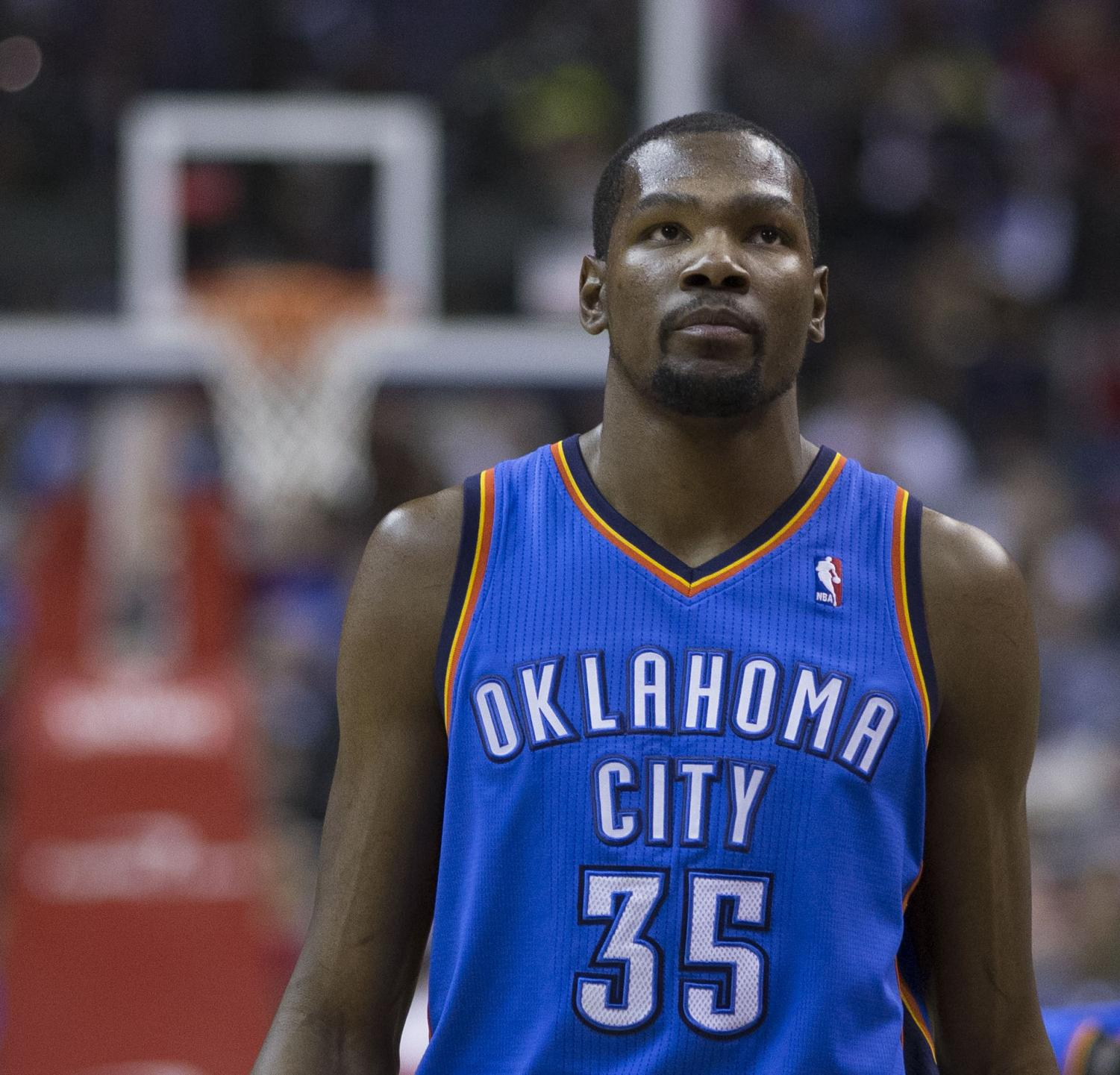 Kevin Durant looks on during the Oklahoma City Thunder's game at the Verizon Center against the Washington Wizards on February 1, 2014. Durant has now won back-to-back championships and Finals MVP with the Warriors, ruining the NBA in the process.