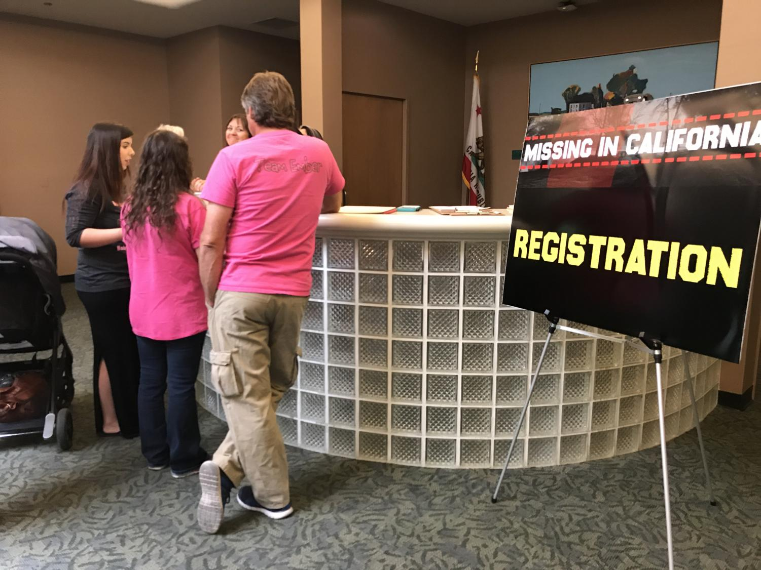 A family checks in at the registration area at the Missing in California conference held at Sacramento State Saturday. A spokesperson from the Sacramento County Sheriff's department said the goal of the conference was to bring clarity to the family members and friends of those who have gone missing.