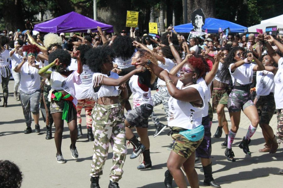 A group of women perform a dance routine for Black Women's March participants following their walk from Crocker Park to the State Capitol building on June 9, 2018. This is the second annual Black Women's March hosted by Black Women United.