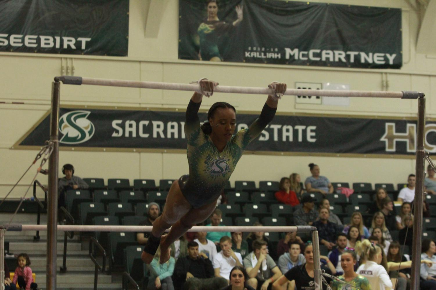 Sophomore Jordyn Brent competing on the uneven bars on March 9 at the Nest. Cal and Stanford headline the teams coming to Sacramento this season.