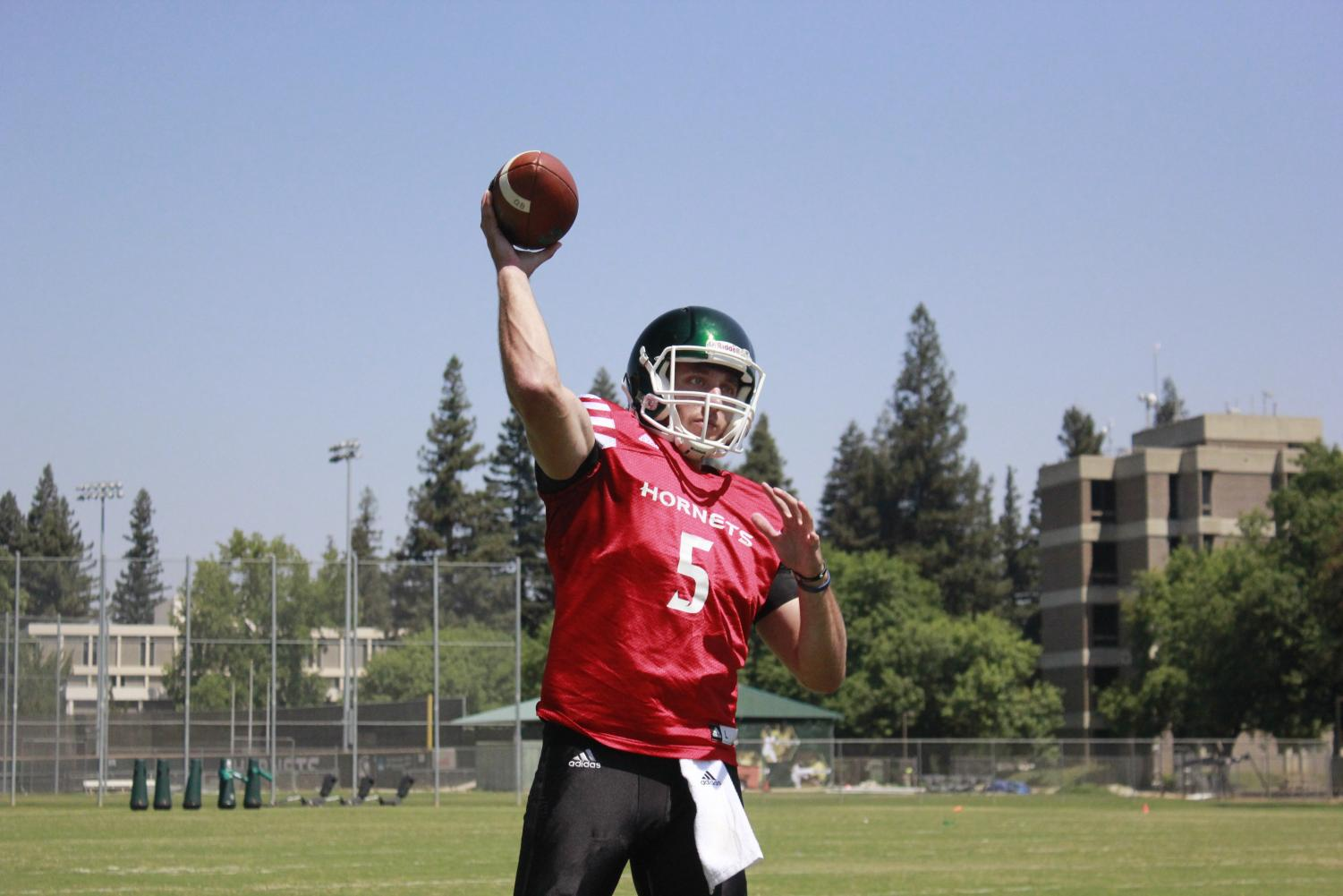 Sacramento State senior quarterback Kevin Thomson throwing a pass during practice Aug. 15. Thomson scored 26 touchdowns while turning the ball over just three times a season ago.