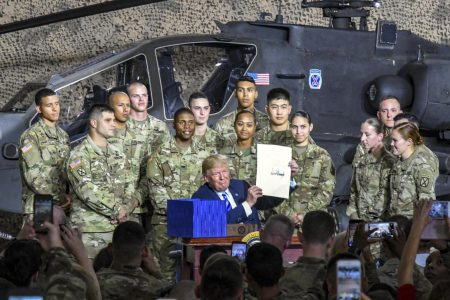 Trump signs the John S. McCain Defense Authorization Act  in Fort Drum, New York.