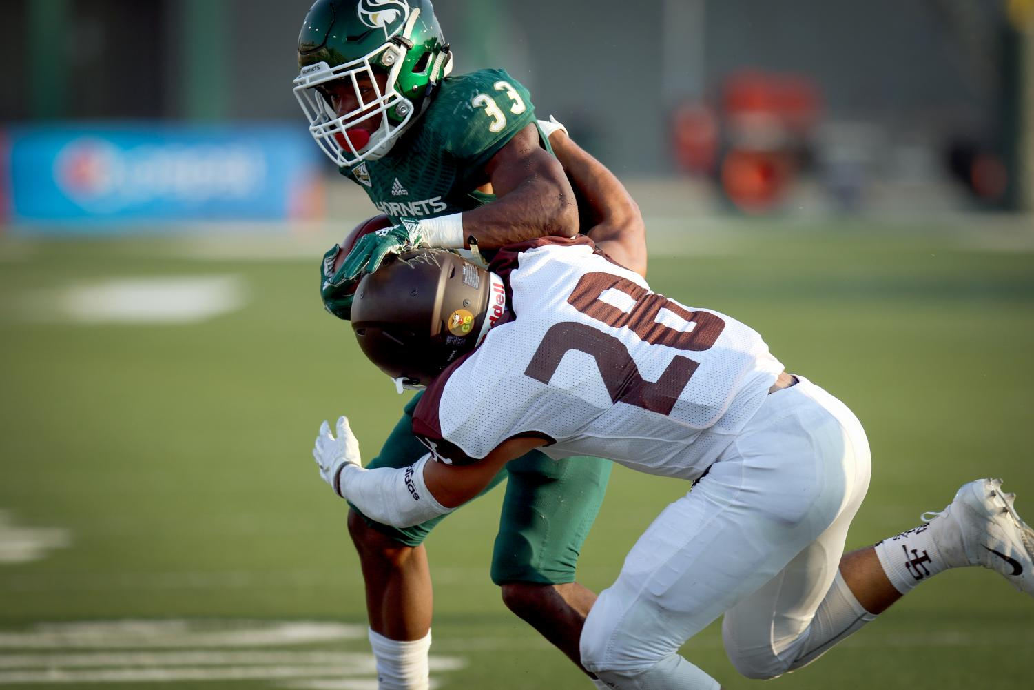 Sacramento State sophomore running back Elijah Dotson is tackled by Rio Strama of University of St. Francis (IL) during the Hornets' first home game of the season on Sept. 1, 2018.