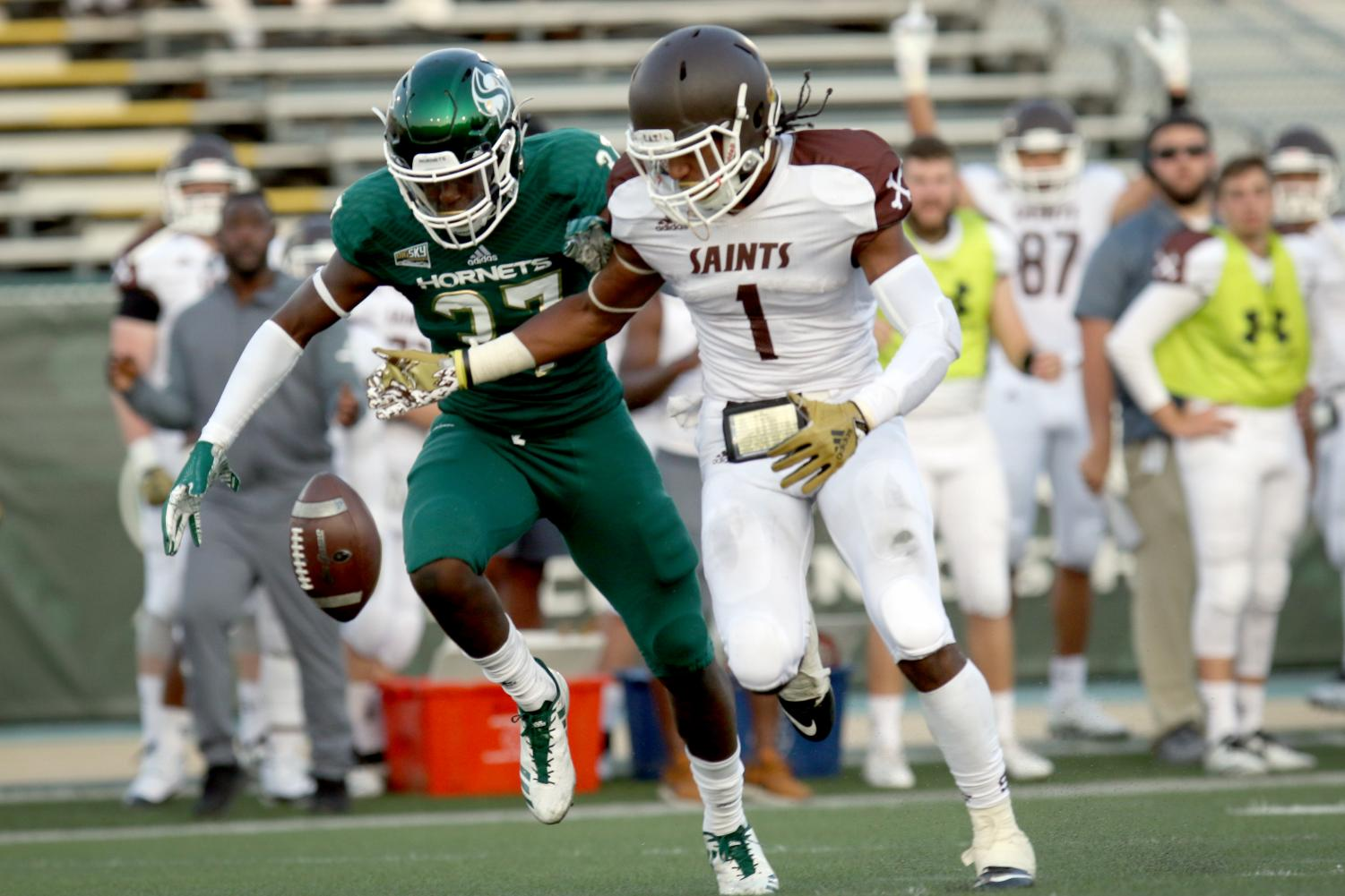 Sacramento State sophomore Daron Bland and Saint Francis wide receiver Ray Vallot watch a pass hit the ground during the first quarter of the Hornets 55-7 win on Sept.1 at Hornets Stadium.