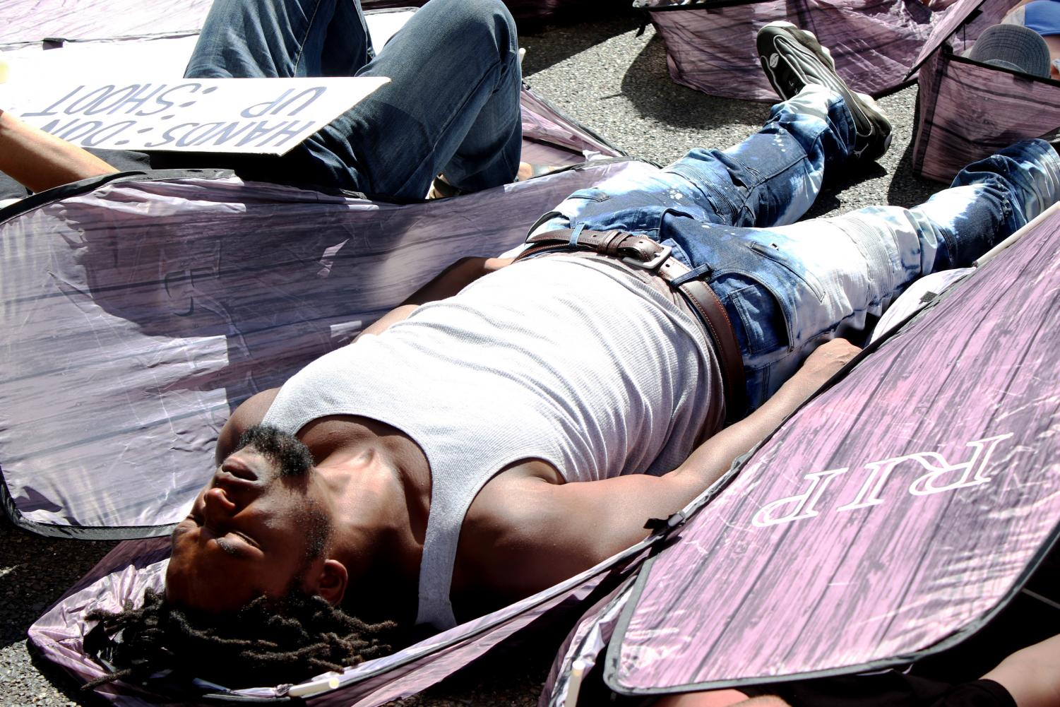 Adam+Braggmartin+lays+down+in+a+coffin+during+the+%27die+in%27+that+happened+at+the+protest+held+on+Tuesday%2C+Sept.+18.+The+protest+was+held+in+response+to+law+enforcement+tactics.