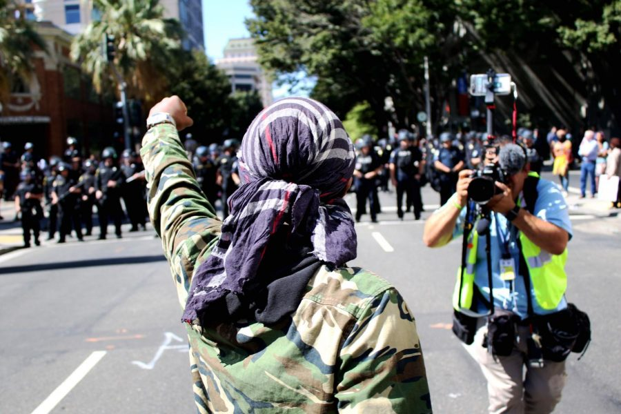 Stevante+Clark+holds+up+his+fist+at+a+protest+in+downtown+Sacramento+on+Tuesday%2C+Sept.+18.+Clark+attended+the+protest+against+law+enforcement+on+the+six+month+anniversary+of+Stephon+Clark%27s+death%2C+his+younger+brother.