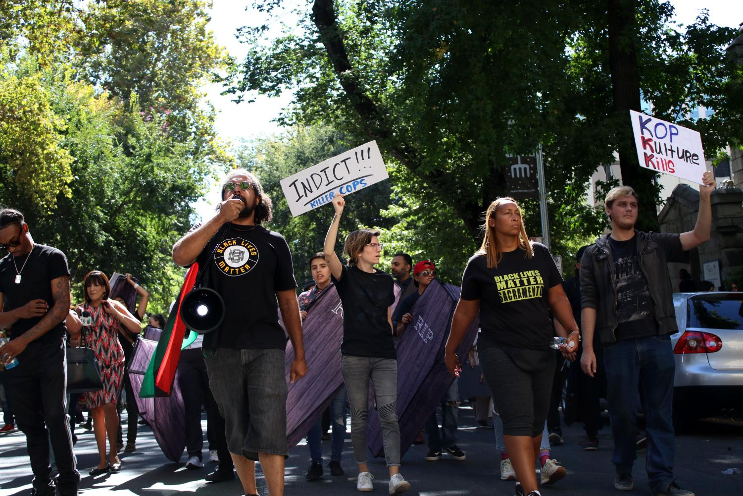 Keyan+Bliss+%28far+left%29+leads+chants+as+protestors+march+in+downtown+Sacramento+on+Tuesday%2C+Sept.+18.+The+protest+was+held+to+express+dismay+towards+law+enforcement.