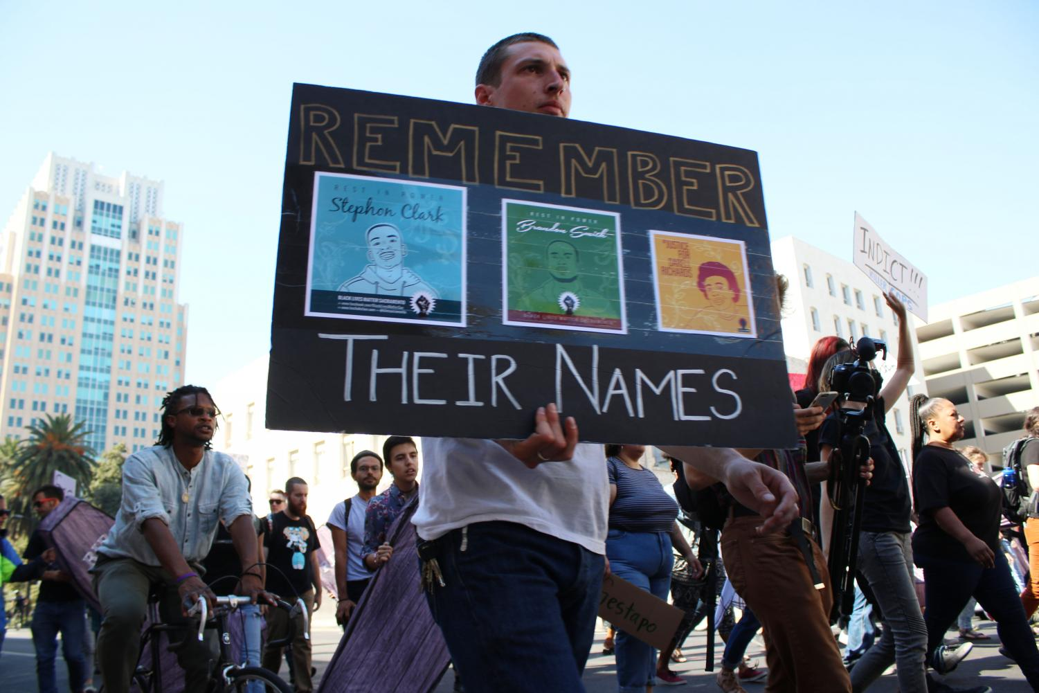 A+man+who+would+not+give+his+identity+holds+a+sign+in+honor+of+Stephon+Clark%2C+Brandon+Smith+and+Darell+Richards+at+a+protest+in+downtown+Sacramento+on+Tuesday%2C+Sept.+18.+The+protest+was+held+on+the+six+month+anniversary+of+Stephon+Clark%27s+death.