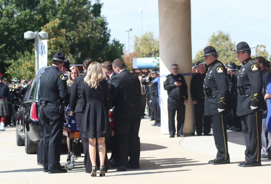 Amy Stasyuk watches as Sacramento County Sheriff officers prepare her husband deputy sheriff Mark Stasyuks casket Saturday, Sept. 29. Mark Stasyuk was shot and killed in the line of duty Monday, Sept. 17 after responding to a disturbance at a Pep Boys Auto Shop in Rancho Cordova.
