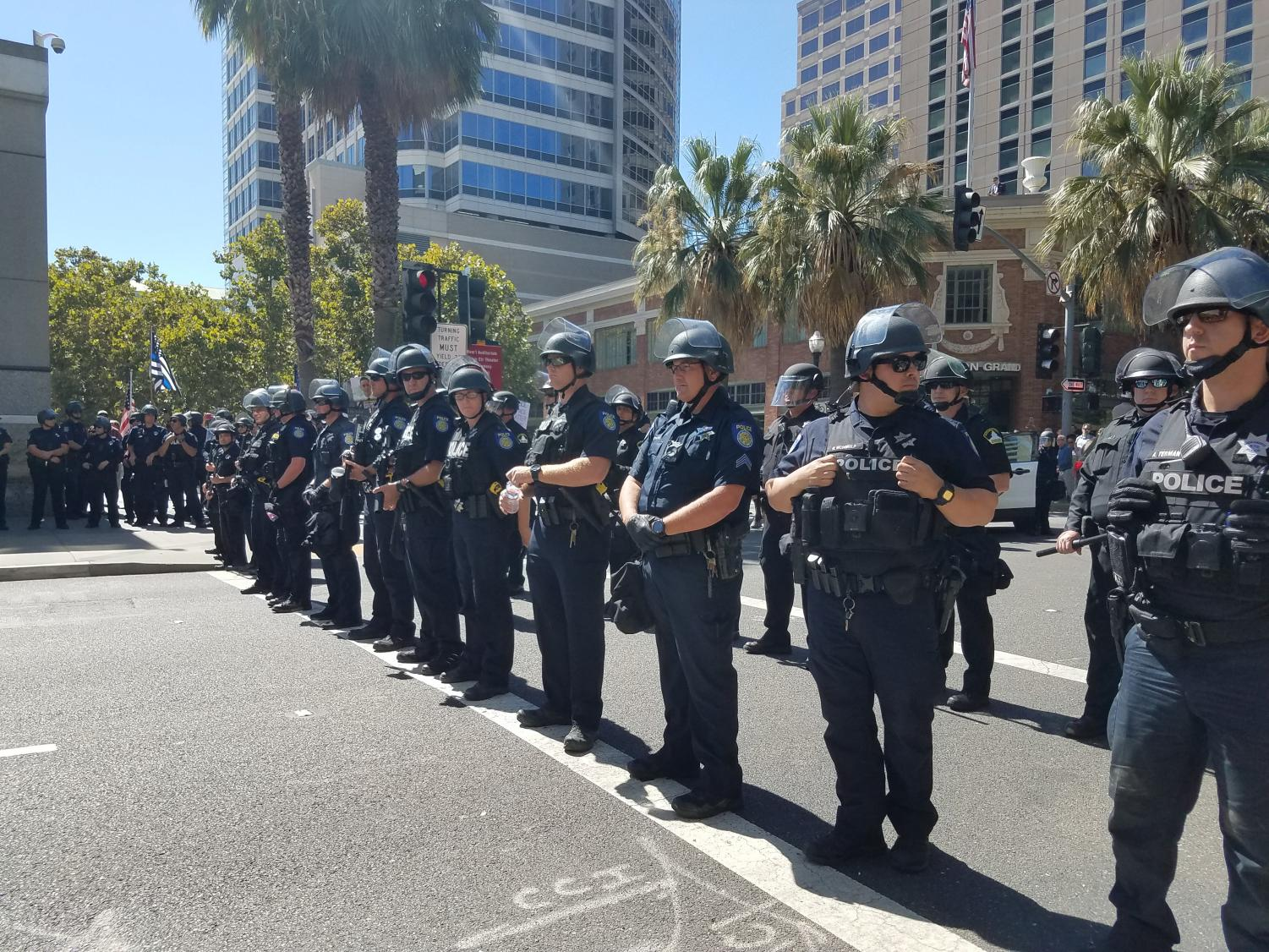 Sacramento+police+form+a+barricade+to+block+of+an+intersection+on+J+street+in+response+to+activists+protesting+in+front+of+the+Sacramento+Convention+Center+on+Sept.+18.+Activists+gathered+to+protest+the+California+Police+Officers+Association%27s+statewide+gathering%2C+which+happened+to+land+on+the+6+month+anniversary+of+the+shooting+of+Stephon+Clark.++