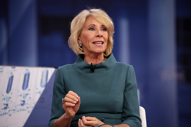 Secretary+of+Education+Betsy+DeVos+at+the+2018+Conservative+Political+Action+Conference+in+National+Harbor%2C+Maryland.+DeVos+is+possibly+rescinding+policies+put+in+place+by+the+Obama+administration+to+require+a+higher+amount+of+evidence+to+be+provided+in+order+to+prove+that+sexual+misconduct+occurred.+