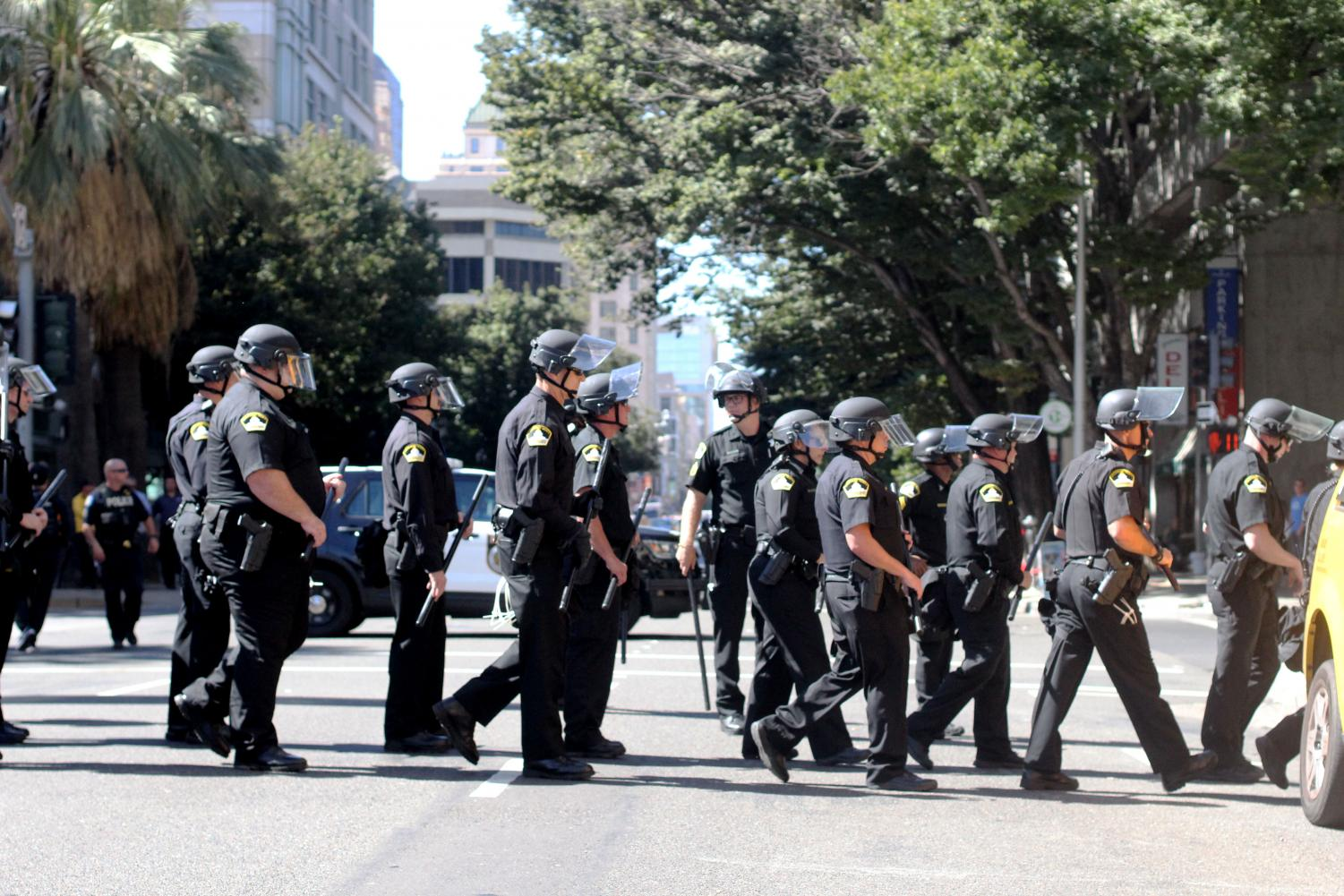 %0APolice+walk+onto+13th+Street+as+they+remove+the+blockade+on+J+Street.+Protestors+originally+on+J+and+13th+Street+marched+away+from+the+convention+center.+