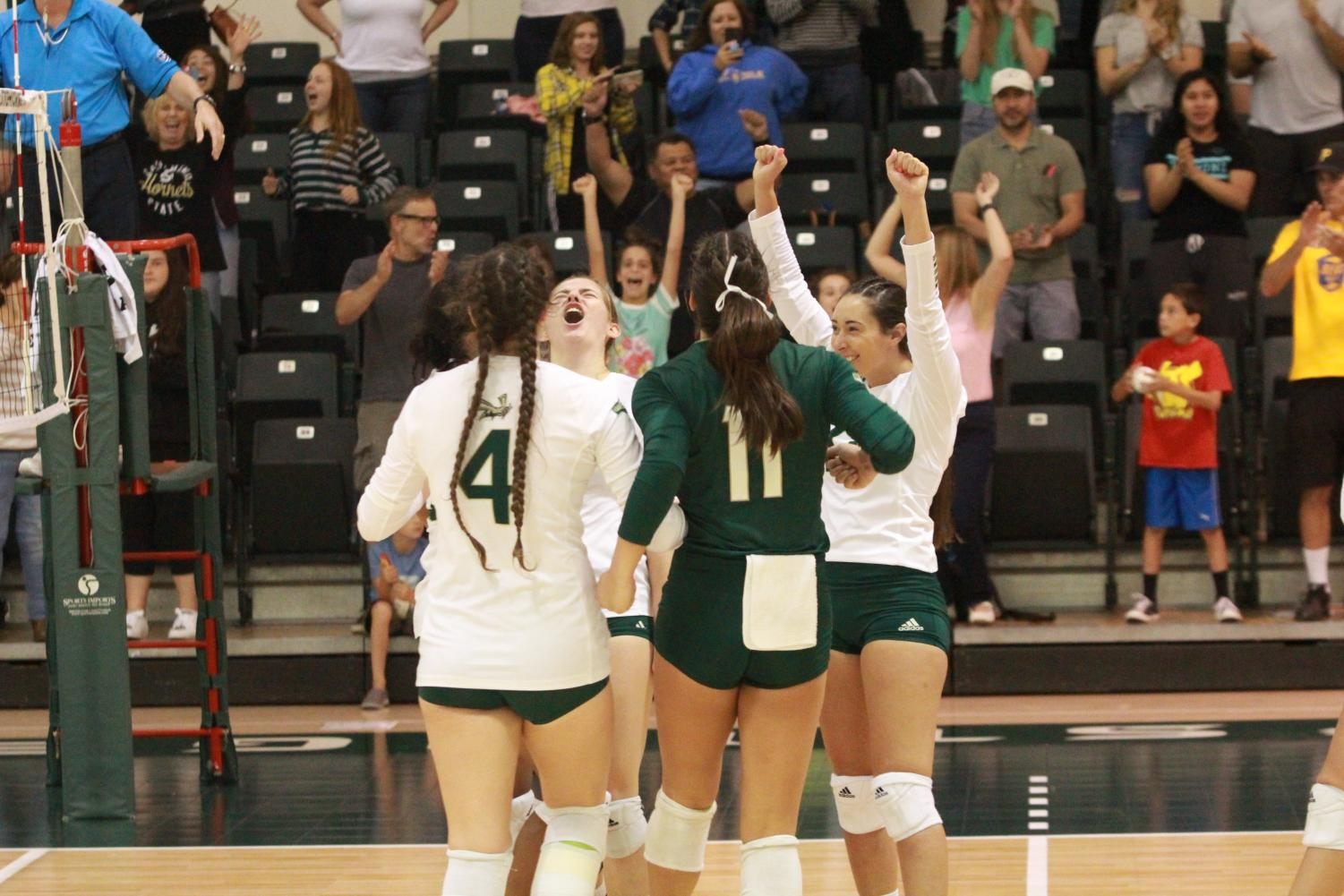 Sac State celebrates a come from behind victory in the fifth set against Northern Arizona at Colberg Court on Saturday Sept. 29.