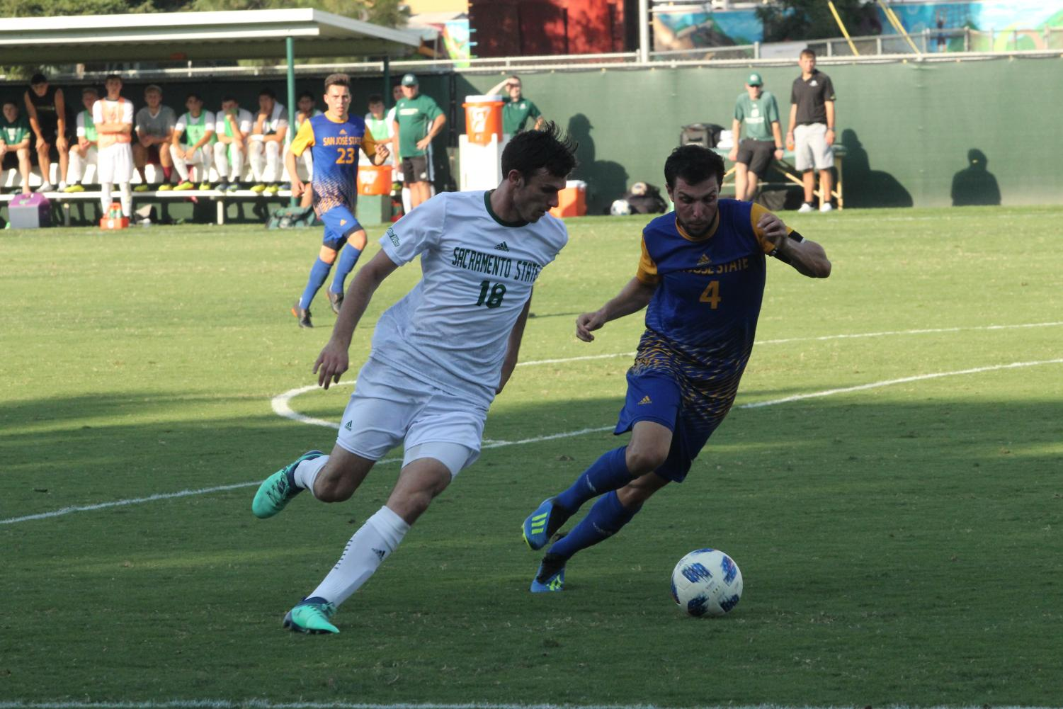 Sacramento State senior forward Brad Bumgarner tries to dribble the ball past Joseph Kay of San Jose State to go towards the goal. The Hornets lost their first home match 2-1 against San Jose State on Sept. 2 at Hornet Field.