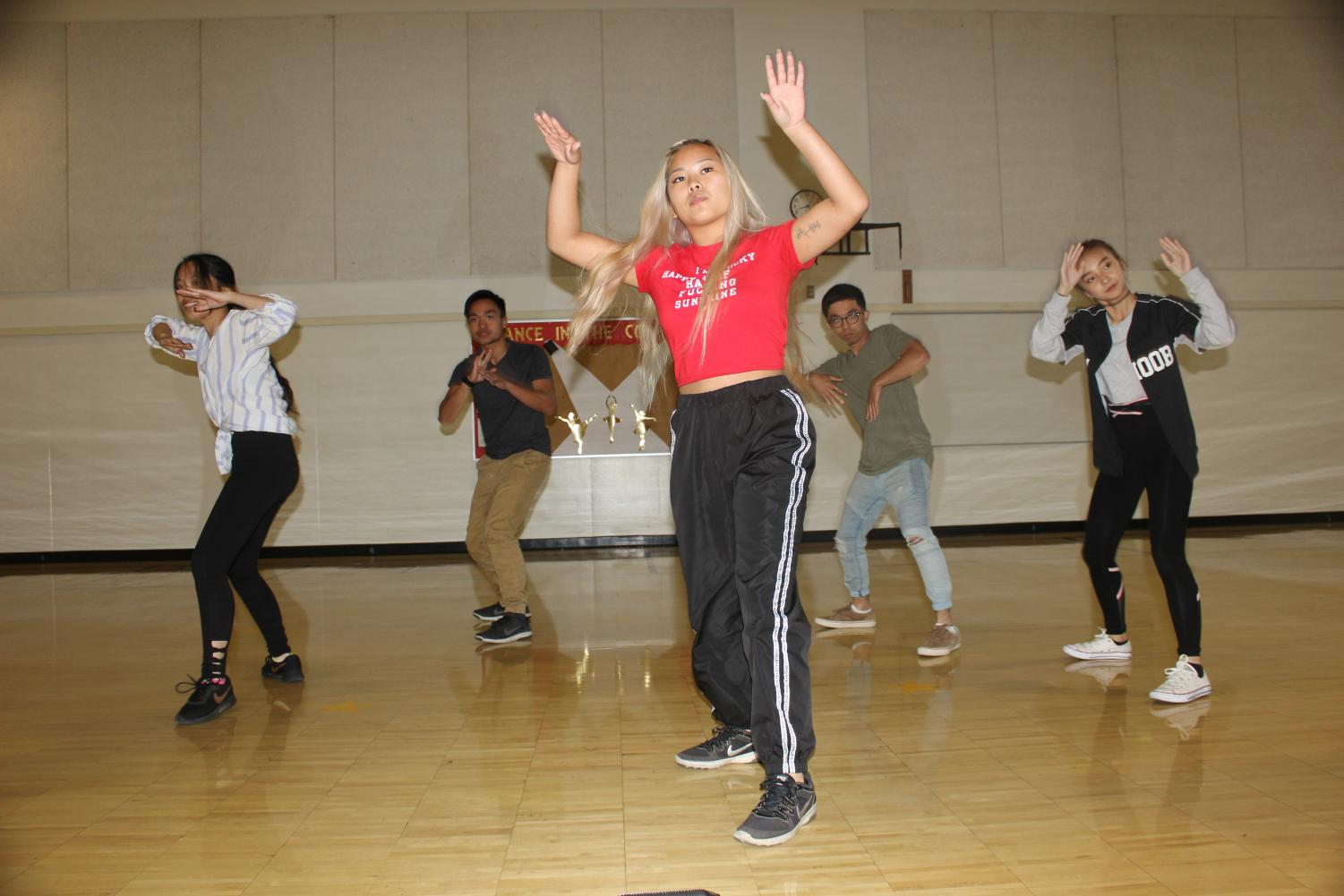 From left to right, Kristina Yang, Mark Joseph Abuda, Melissa Lee, Anthony Bernardez and Joyce Vang running their winning dance set they performed at the SacAnime K-pop battles on Sept. 1, 2018.