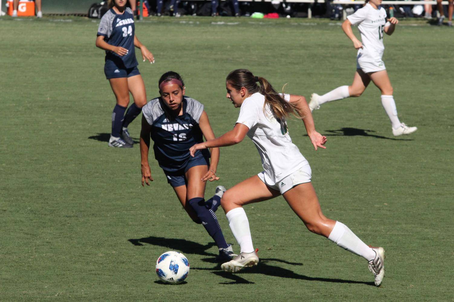 Sacramento State Hornet forward Julia Herrera dribbles the ball past Nevada Wolf Pack forward Analyse Talavera. The Hornets won their first match of the year against Nevada 3-2 on Sept. 7 at the Hornet Field.