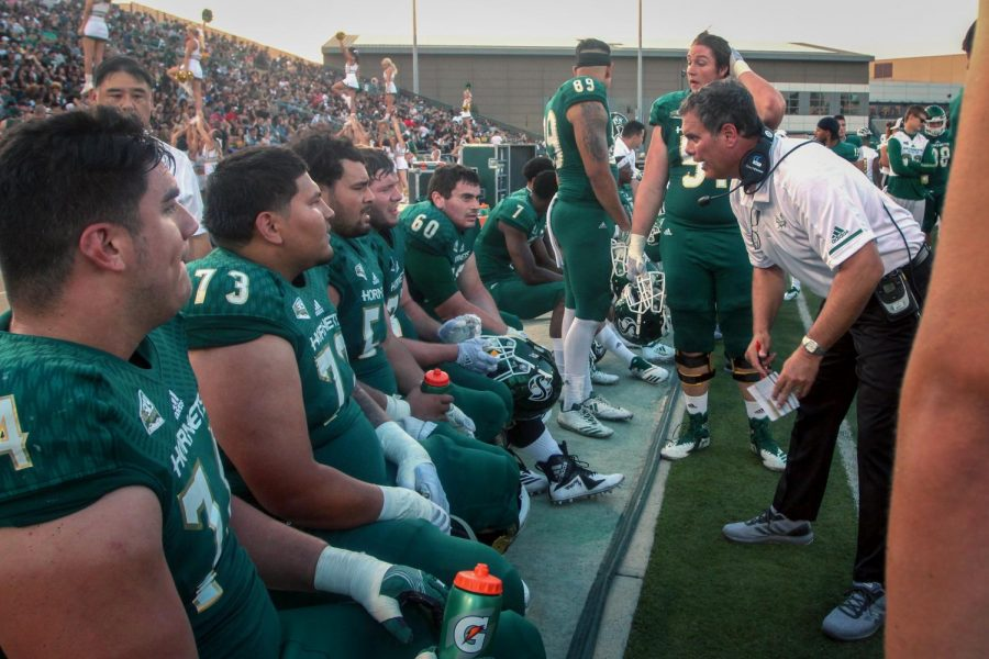 Assistant head coach Paul Wulff speaks with his offensive line during Sacramento State's opener against Saint Francis on Sept. 1. The Hornets fell to San Diego State in their second game 28-14 on Sept. 8.