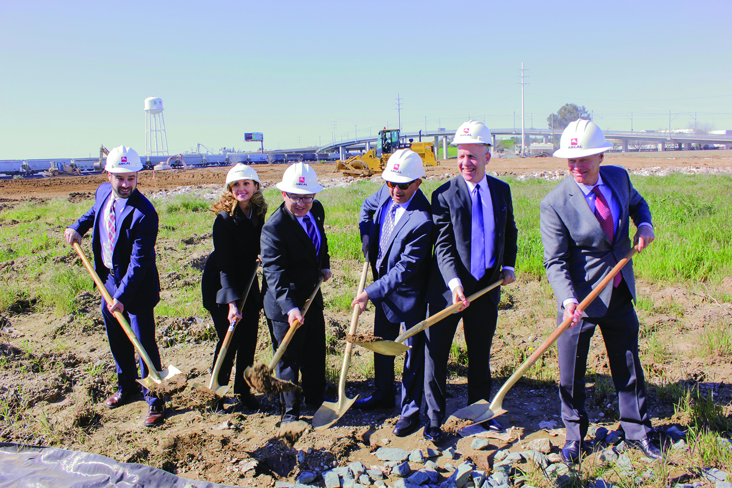 Mayor Darrel Steinberg, second from right, joins others in ceremonially breaking ground at The Crossings in May 2017. The Crossings are now open, joining other student living communities surrounding campus.