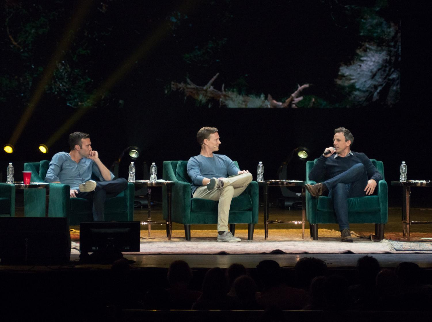 From left to right, Jon Favreau, Tommy Vietor and guest Seth Meyers at a live taping of