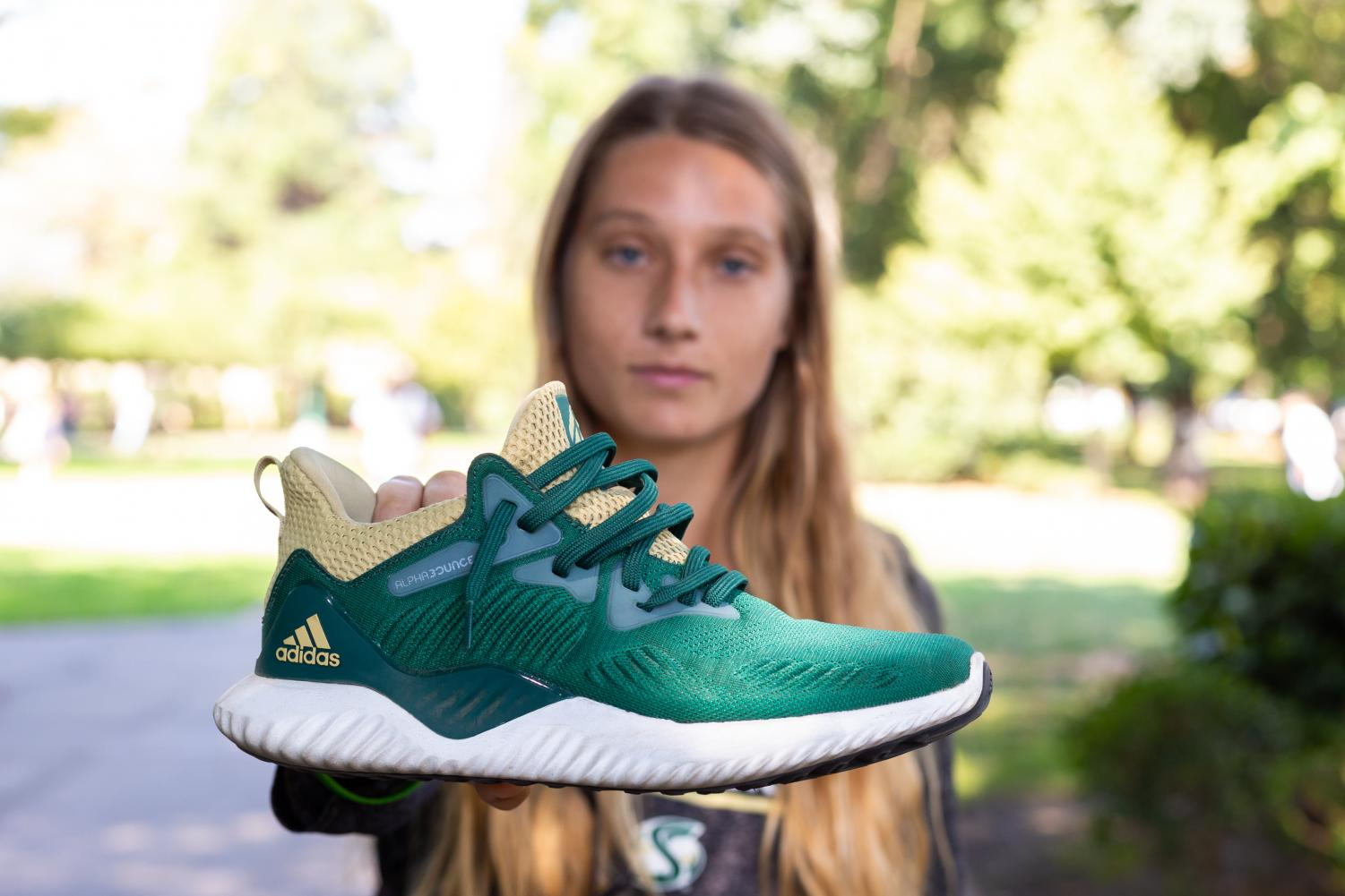 Sacramento State sophomore, Shay Valenzano, holds her custom Adidas Alphabounce on Friday, Aug. 31.