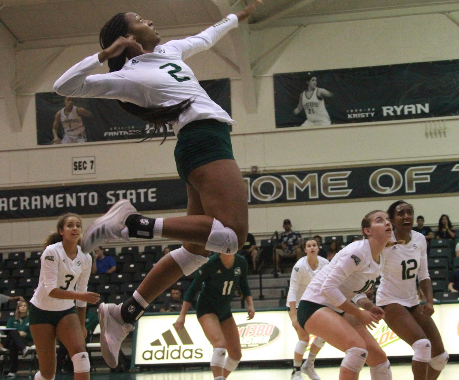 Sac State sophomore outside hitter Cianna Andrews anticipates striking the ball against the University of Nevada on Sept. 8.