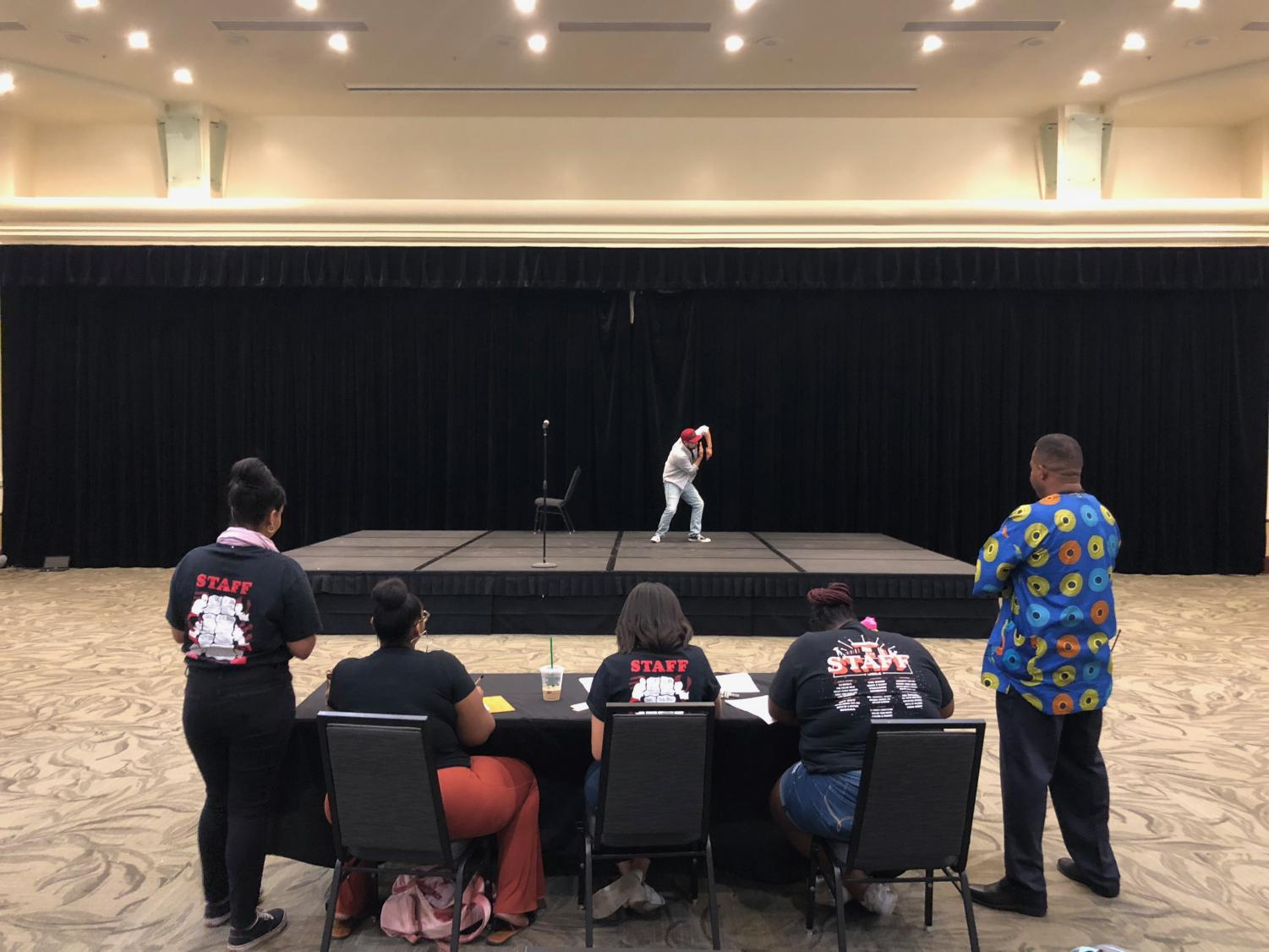 From left to right, Gabriela Mascoll, Tynisha Jones, Danielle Carr, Audriana Berry, and Ajamu Lamumba watch Sac State student Kevin Gutierrez perform his freestyle hip hop routine in the University Union Ballroom on Thursday, Sept. 20, 2018.