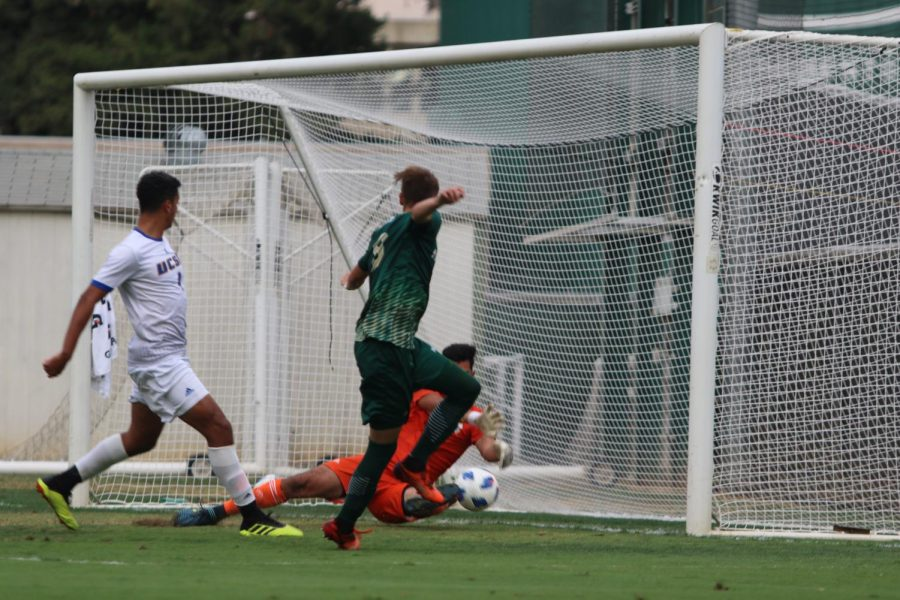 Sac State forward Benji Kikanovic attempts to score a goal, but the ball is blocked by UC Santa Barbara's goalie Alan Carrillo. The Hornets defeated the Gauchos 1-0 in its first Big West Conference match on Wednesday, Oct. 3.