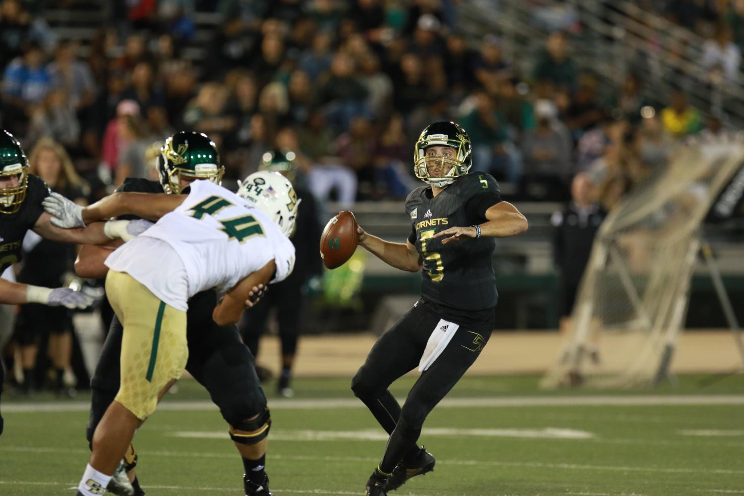Sac State senior quarterback Kevin Thomson looks to pass during the Hornets 41-27 loss to Cal Poly on Oct. 6. The Hornets head to Southern Utah to continue Big Sky Conference play on Saturday at 5 p.m.