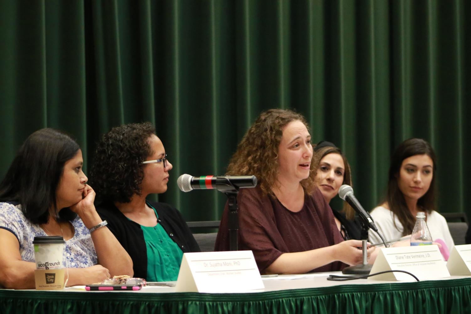 Sujatha Moni, Diana Tate Vermeire, Beth Lesen, Alexa Sardina and Makenzie Neves discuss with students the ramifications of the appointment of Brett Kavanaugh to the U.S. Supreme Court. Panelists discussed concerns with Kavanaugh's partisanship and temperament and compared the treatment of Christine Blasey Ford to Anita Hill.