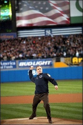 President George W. Bush throws out the first pitch during game three of the World Series game between the Arizona Diamondbacks and the Yankees at Yankee Stadium Oct. 30, 2001.