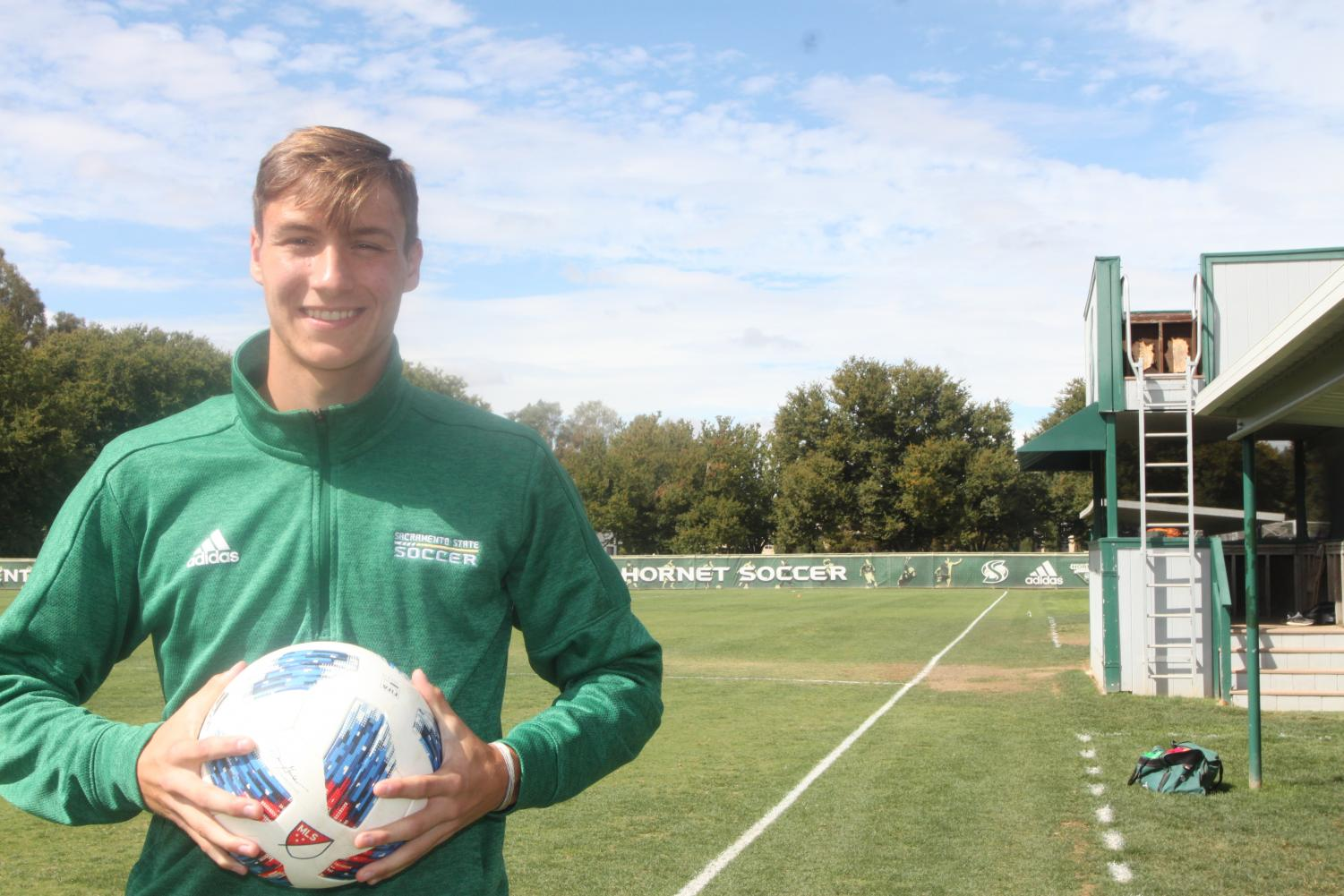 Sac State men's soccer forward Benji Kikanovic holding a soccer ball at Hornet Field Oct. 4. Kikanovic has five goals as a freshman this season.