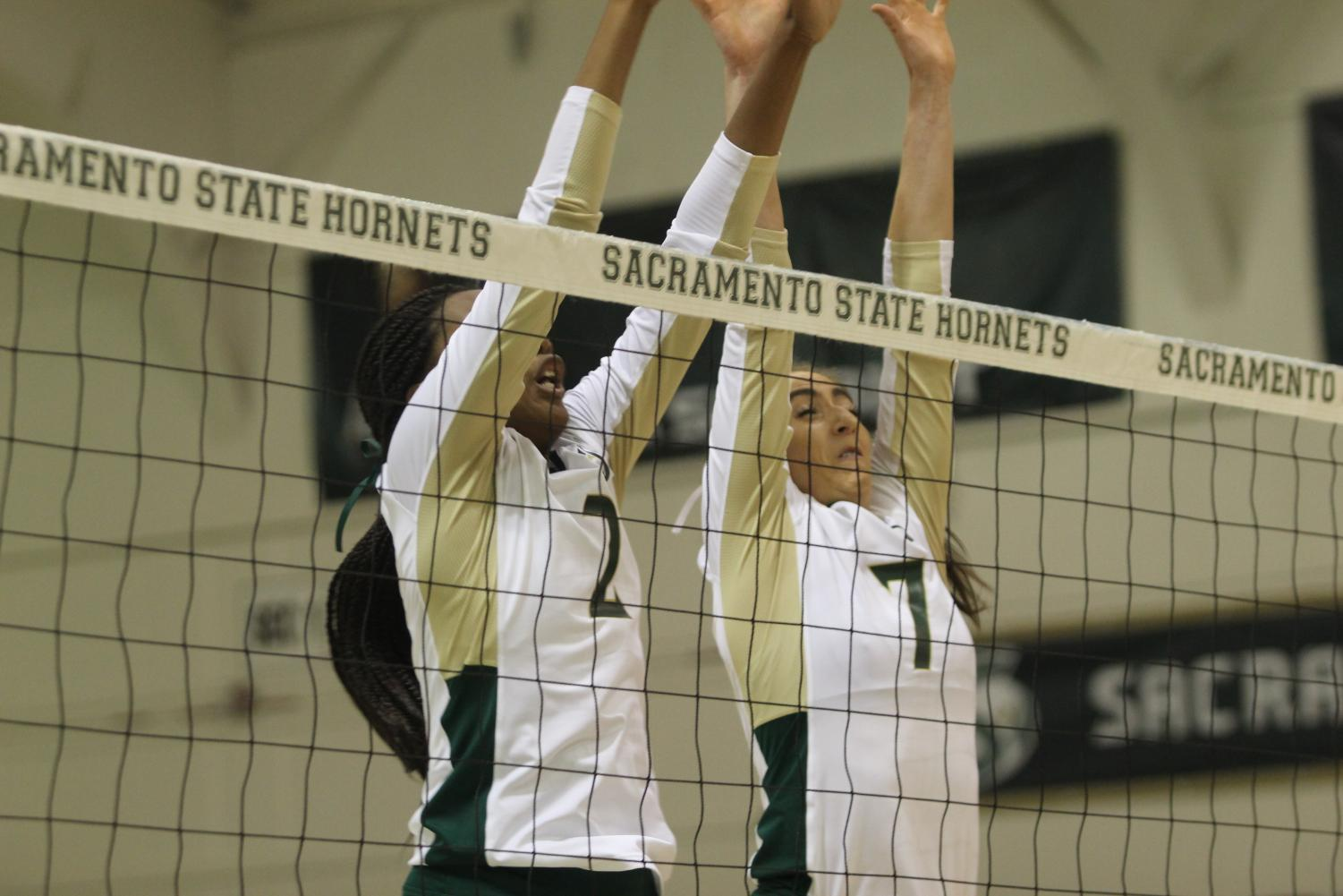 Sac State sophomore middle blocker Cianna Andrews and senior middle blocker Lana Brown go up for a block against UC Davis in the first set on on Sept. 4. The Hornets swept  Southern Utah University on Saturday.