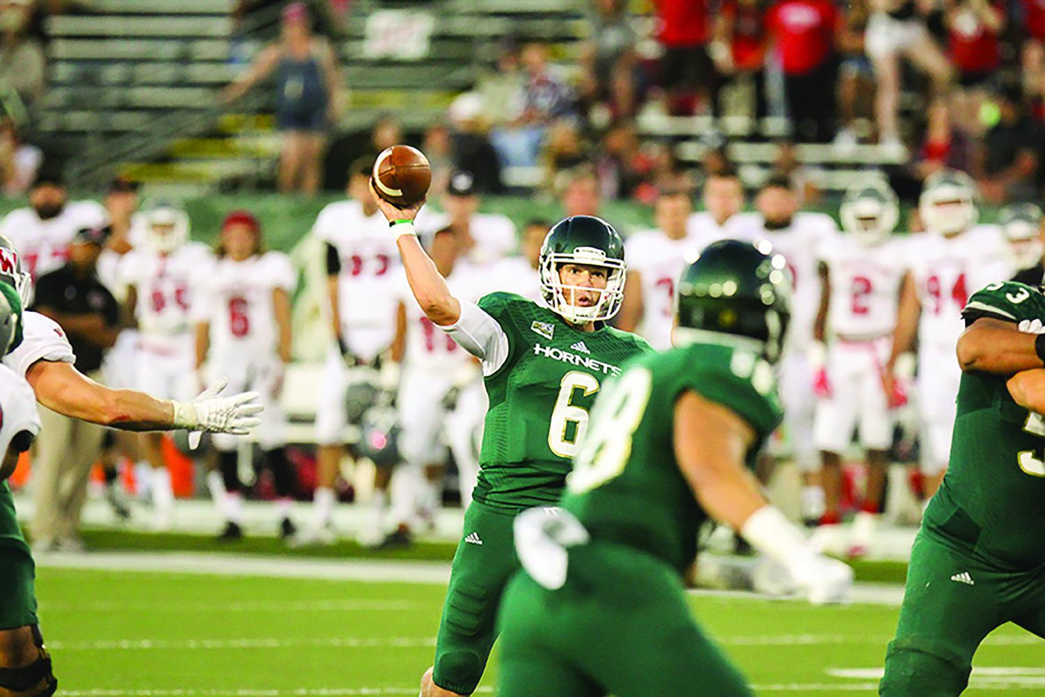 Sophomore Nate Ketteringham throws the ball against Western Oregon, Sept. 3, 2016. Ketteringham is one of many football players that transferred from Sac State soon after Jody Sears took over as head coach.