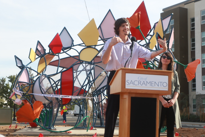Sacramento State senior studio arts majors Chris Duffy and Tiffany Boddeker speak at the unveiling ceremony of their 16-foot by 16-foot steel