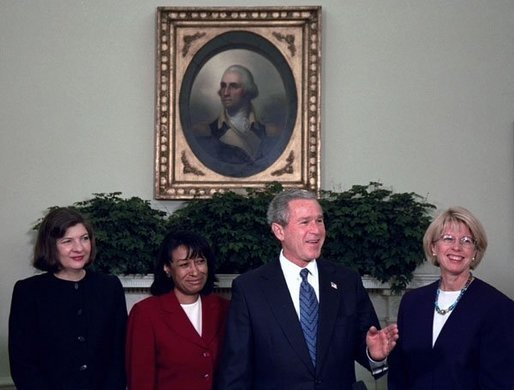 Then-President George W. Bush introduces his judicial nominees Justice Priscilla Owen, left, Justice Janice Rogers Brown, center, and Judge Carolyn Kuhl in the Oval Office Thursday, Nov. 13, 2003. Brown is being considered by President Donald Trump to replace Jeff Sessions as Attorney General, who quit Wednesday morning.