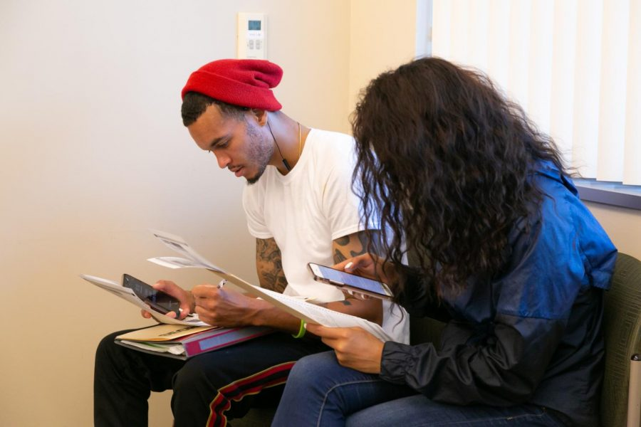 Patrick Asberry (left), senior at Sac State, and Emily Franklin, sophomore at Sac State filling out their ballots inside Modoc Hall on Election Day, Tuesday, Nov. 6 2018. Asberry and Franklin are two of many Sac State students who used the voting center on campus, the first of its kind at any CSU campus.
