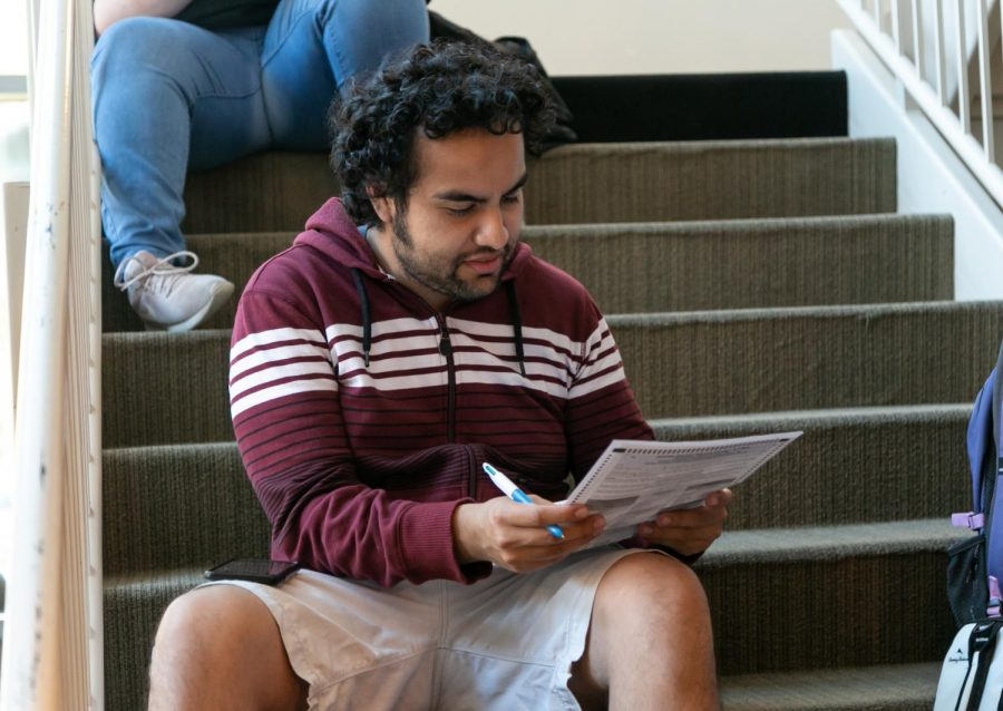 Sac+State+alumni+Manuel+Angel+Serrano+fills+out+his+ballot+inside+Modoc+Hall+on+Election+Day.